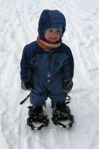 kid snowshoeing at kickapoo valley