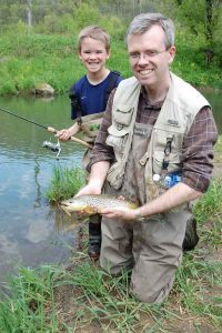 father and son trout fishing in the driftless
