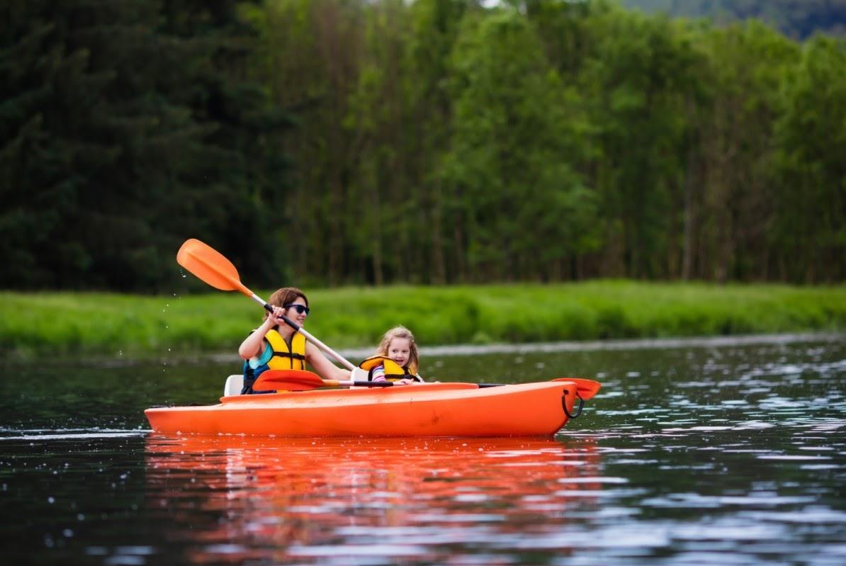 Mom and daughter kayaking